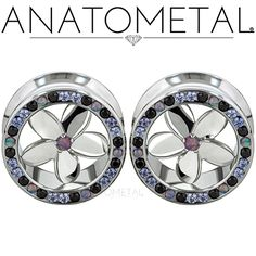 """3/4"""" Plumeria Eyelets in ASTM F-138 stainless steel with silver Plumeria Inserts: Black CZ, Lavender CZ, synthetic Tanzanite and synthetic Opal #38 gems"""