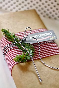 Christmas sprig of fir tree and red and white checkered fabric make for a very pretty organic gift.