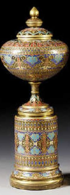 A massive pair of Continental enamelled 'Persian-style' amber-tinted vases, covers and stands in the Lobmeyr style,...