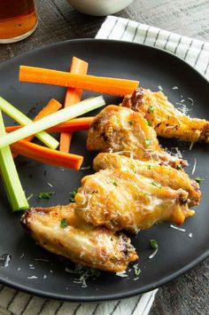 Easy garlic parmesan wings are air-fried or baked to perfection to get extra crispy then doused in a garlicky buttery glaze with a lot of parmesan cheese. Parmesan Chicken Wings, Tandoori Chicken, Air Fry Chicken Wings, Baked Garlic, Chicken Wing Recipes, Air Fryer Recipes, Big Game, Game Night, Glaze
