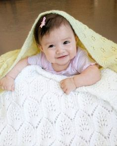 Fiber Trends Pattern CH48e - PDF<br><br>Design by Eugen K. Beugler<br><br>Choose between two lovely laces to welcome a newborn with a cozy blanket. <br> <br> Eyelet Flowers combines a small lace pattern with knit and purl basketweave for cozy thermal warmth.<br> Lace Plumes connect an easy-to-memorize lace for an overall pattern that is special enough for a christening and practical enough for everyday use. <br><br>Blocked Size: <br&g...