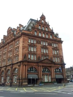 The distinctive red sandstone of 'the grand old lady' at Edinburgh's West End. The Caledonian, A Waldorf Astoria Hotel.