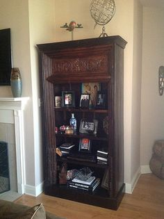 Kristi Sahebi and her husband purchased this one-of-a-kind bookshelf, the airplane accessory and the tray that is in the bookshelf from Discoveries. She told me her husband is from Iran and was thrilled when he saw the tray with the Shah and his wife.