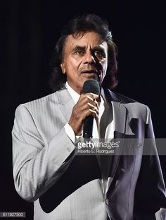 News Photo : Recording artist Johnny Mathis performs onstage...