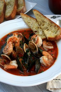 Spicy Shrimp Cioppino: Cioppino is a fish/seafood stew originating in San Francisco, California. It is considered an Italian-American dish. Fish Recipes, Soup Recipes, Cooking Recipes, Healthy Recipes, Spicy Seafood Recipes, Bread Recipes, Cooking Tips, Shrimp Dishes, Fish Dishes