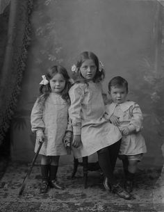 These are the three children of a Mrs Murdoch from Cahir, Co. Tipperary. No particular reason for choosing this photo other than that their cuteness score is off the charts, and the oldest girl has really compelling eyes. Love the little brother's nonchalant leaning on his big sister too.    Date: 27 September 1905