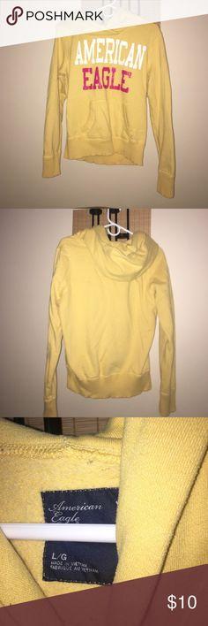 American Eagle Hoodie Yellow American Eagle Hoodie. Worn . Had a few years . American Eagle Outfitters Tops Sweatshirts & Hoodies