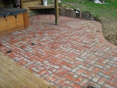 Basket weave brick patio. Laid tightly, but loose so that the bricks