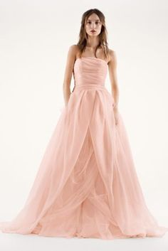 This magnificent textured organza wedding dress with draped bodice, split-front overlay, and asymmetrical skirt is awe-inspiring. 4 extra length gown. This textured organza ball gown has a beautifu