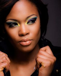 Vibrant colors eye shadow on pretty brown skin make up