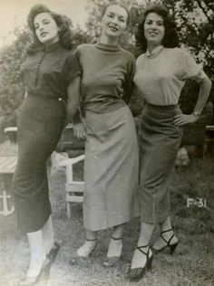 C.1950s When we weren't wearing poodle skirts and saddles, we could be seen in these pencil straight skirts and tight sweaters.