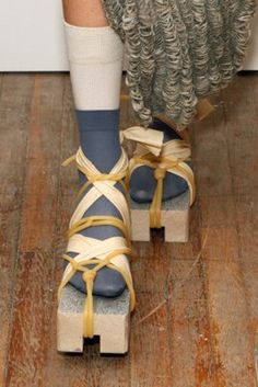 """""""The next time you run out of shoes, remember to try tying a brick to your feet with spaghetti."""" by Eckhaus Latta, New York Fashion Week 2012"""
