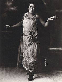 Bessie Smith   Legends of Blues.  Her dress looks 20's, but I could be wrong.  She looks amazing, regardless of era.