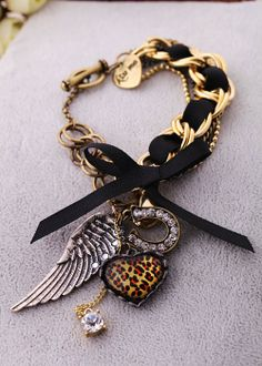 Vintage gold and black charm bracelet