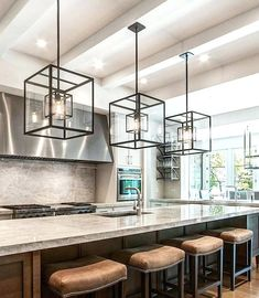 modern kitchen island pendant lights cube cage lighting complete with bulbs complements an kitchen island light fixture and stools for modern pendant lights over kitchen island