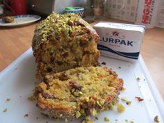 Corgette and Orange Loaf topped with orange flavoured icing and pistachios
