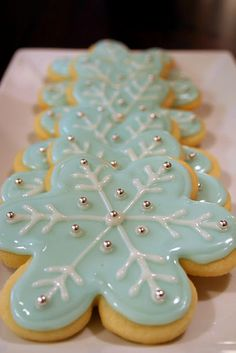 Snowflake cookies with sugar glaze icing. I have always wondered how to make this kind of icing! via #TheCookieCutterCompany