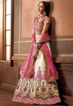 This Art Silk Circular #Lehenga sets fashion #goals. Such a #pretty flare in #Beige with #vibrant and #beautiful #floral #embroidery. The embroidered choli in #Pink is a perfect match. Product Code: LQM40