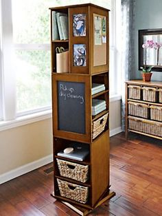 This swivel cabinet is so cool. It packs a ton of storage in a tight space - cork board, chalkboard, shelves, hooks, cubbies and more! Perfect for a home office -- Swivel cabinet free standing shelves - storage tower