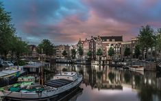 Download wallpapers Amsterdam, channels, barges, ships, evening, Netherlands, Holland