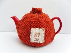 Tea Cosy orange hand knitted snug cosy cosie in tangerine orange 100% merino wool.  Cute embroidered tea bag , wood beads