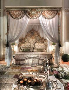 Love this elaborate bedroom in layered whites and neutrals.