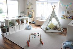 Nice and bright playroom with all the essential elements - cozy teepee, book shelves and space for pretend play!