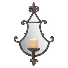 HOME DECOR – ILLUMINATION – CANDLE SCONCE – Mirrored candle scone with scrolling fleur-de-lis accents. Product: Candle sconce Construction Material: Metal.