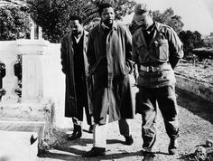 Nelson Mandela and Robert Resha meeting with an officer in the Algerian army, 1962. Photo courtesy of Have You Heard From Johannesburg (www.clarityfilms.org)