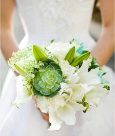 This is very pretty. It adds a quirky twist to what seems top be a very #classic wedding. #Wedding #Bouquet #White #Succulent #weddingdress #bride.@lexiemondragon