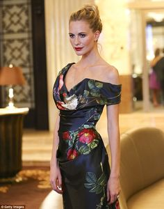 Blonde beauty: Poppy Delevingne looked fantastic in a fetching floral Vivienne Westwood dress as she attended the Vienna Fashion Night in the Austrian city on Thursday night