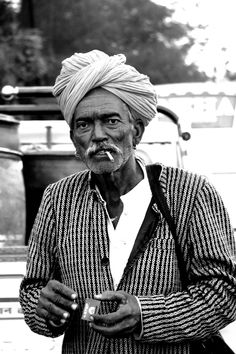 https://flic.kr/p/D4XJHG | Man in turban | Man on the street with lights.. Smoke in the mouth and lights in hand and a pagri on the head..typical rajasthani man..