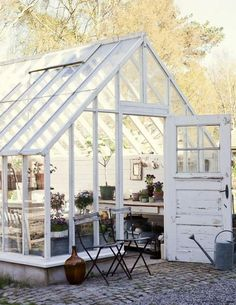 A guide to transforming your garden shed Rustic greenhouse and garden shed. Industrial style with outdoor seating and vases. More ways to revamp your garden shed at . Greenhouse Shed, Greenhouse Gardening, Simple Greenhouse, Indoor Greenhouse, Greenhouse Wedding, Homemade Greenhouse, Dream Garden, Home And Garden, Glass House Garden