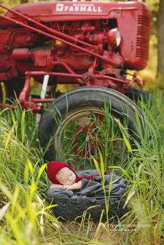 Outdoor newborn session- baby boy with a red tractor in spring Erica Courtine Photography Newborn Baby Photos, Newborn Shoot, Newborn Pictures, Baby Boy Newborn, Baby Boys, Outdoor Newborn Photography, Photography Ideas, Infant Photography, Urban Photography