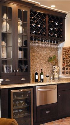 small wet bar with mini fridge, sink, overhead glass cabinets and ...