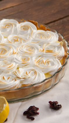 Recipe with video instructions: The classic fave gets prettified with a flower meringue topping. Ingredients: 1 pie crust, ⅔ cup sugar, 3 eggs, Zest and juice of 5 lemons, ¼ cup cornstarch, ½ cup cold butter, cubed, For the meringue:, 3 egg whites, ¾ cup sugar, 4 Tbsp water