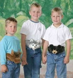 LMFAO, Some one please...Omg, it's bad enough the first kid has a mullet tail on the back of his head,but he has to wear a furry animal, fanny pack too?!