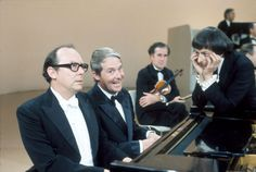 Eric Morecambe, Ernie Wise and André Previn on 'The Morecambe and Wise Christmas Show' in 1971.