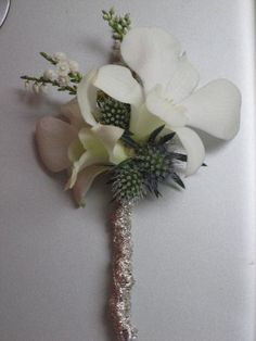 White dendrobiums with eryngium