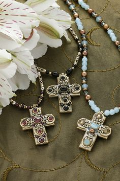 Stunning with a modern flair. This gemstone cross necklace is a lovely gift for any special woman in your life. The fascinating array of stones and crystals make this a delightful and unique piece of