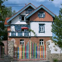 haus by bine-braendle   If follow this pin you will see an amazing house full of color and whimsy by an artist who has turned her house into her canvas.
