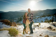 Dog Sandwiched between Couple in Cute Engagement photo