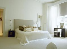 Kelly hoppen bedroom - dark furniture on light walls and floor,  Neutral black out blinds with floaty curtains.