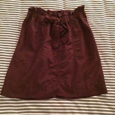Merona Plum Skirt Plum Merona skirt with tie front elastic waist and pockets. In good condition. 20% off bundles! Merona Skirts