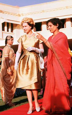 The Queen 1961  During the Royal Tour to Pakistan, Queen Elizabeth II is pictured at a costume parade in Karachi, wearing a gold dress and feather hat.