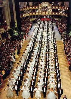 Thirty minutes or an hour after doors open Viennese balls formally begin with the opening ceremony, which includes a polonaise, a waltz, and either the Fledermaus Quadrille or an originally choreographed dance. This is always performed by the opening committee, which consists of dozens of young couples dressed in black (men) and white (women).  The opening ceremony may also include short ballet, opera, or orchestral performances, as well as a brief speech by a prominent dignitary.