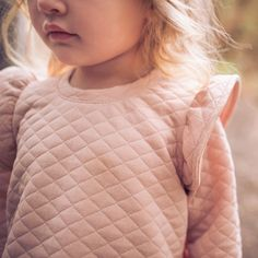 Every little girl needs that perfect tunic dress, and theres no need to look any further! Sometimes it's the little things. Between the luxurious quilted jacquard fabric and the ruffle detailing on th