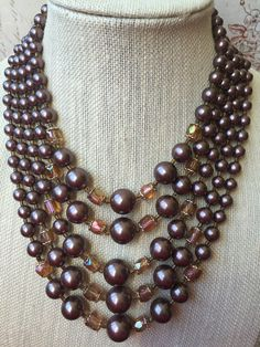 Hey, I found this really awesome Etsy listing at https://www.etsy.com/listing/277662048/faux-pearl-crystal-vintage-multi-strand