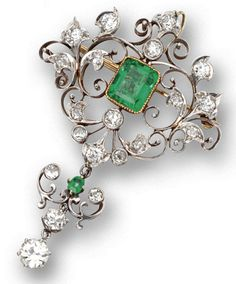 EMERALD AND DIAMOND PENDANT-BROOCH, CIRCA 1900.  The openwork cartouche of scrolling foliate design, set in the center with an emerald-cut emerald weighing approximately 2.80 carats, framed by old-mine diamonds, supporting a pendant set with additional old-mine diamonds and a small emerald-cut emerald, the total diamond weight approximately 3.70 carats, mounted in gold and platinum.