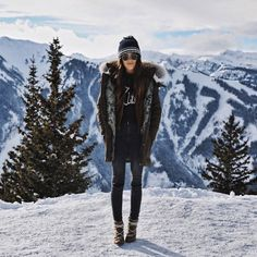 Wear your parka with a beanie, graphic sweater, jeans, and snow boots.